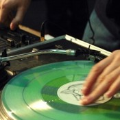 Close-up detail of a DJ mixing on Technics record decks, UK 2000's